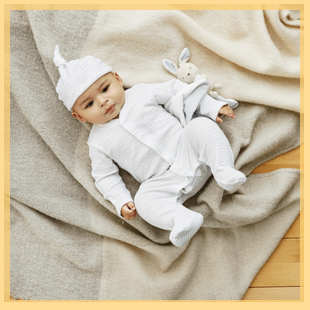 Baby in a sleepsuit