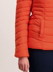 Orange Coat In A Bag
