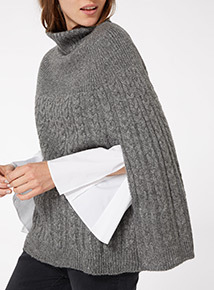 Grey roll neck cable knit cape