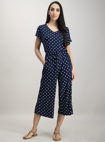 Online exclusive navy spotted v-neck jumpsuit